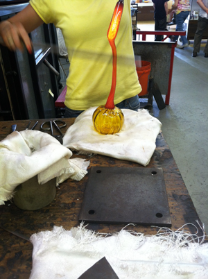 The shaped glass for the stem is dropped onto the pumpkin...