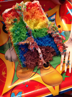 A cut slice of the DisneySide cake, made with the Duff Goldman Tie-Die Cake Mix