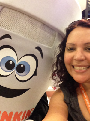 Dunkie of Dunkin Donuts taking a selfie with me at the Expo
